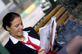 Businesswoman reading magazine Stock Photos