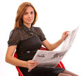 Businesswoman reading a newspaper Stock Image
