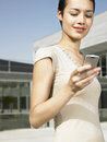 Businesswoman Reading Text Message On Cellphone Royalty Free Stock Photo