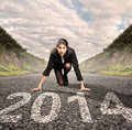 Businesswoman ready to start year on a road run Royalty Free Stock Photos