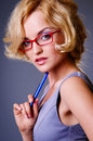 Businesswoman in red glasses Stock Image