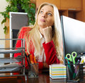 Businesswoman in red having a tedious time young at office Royalty Free Stock Photos