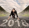 Businesswoman on a road ready for 2018 Royalty Free Stock Photo