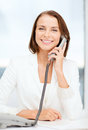 Businesswoman with rotary phone calling business and helpline concept Stock Photos