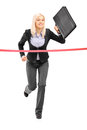 Businesswoman running and reaching the finish line full length portrait of a with a briefcase isolated on white background Stock Photos