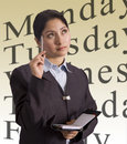 Businesswoman and schedule Royalty Free Stock Images