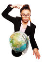Businesswoman scratching her head while thinking looking at an earth globe and in doubt isolated on a white background Royalty Free Stock Photo