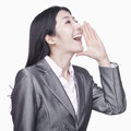 Businesswoman screaming Stock Photo