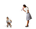 Businesswoman screaming at lazy woman big angry over white background Stock Photography
