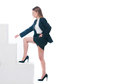 Businesswoman or secretary climbing in her society Royalty Free Stock Photo