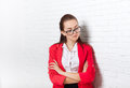 Businesswoman serious upset look down ponder wear red jacket glasses thinking business woman over office wall Stock Images