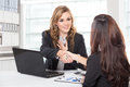 Businesswoman shaking hand after a long negotiation Royalty Free Stock Photo