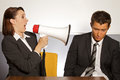 Businesswoman shouting at businessman through megaphone Royalty Free Stock Photography
