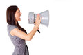 Businesswoman shouting on his megaphone angry with loudspeaker Stock Images