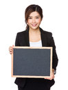 Businesswoman showing empty chalkboard Royalty Free Stock Photo