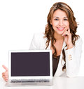 Businesswoman showing a laptop screen Stock Image