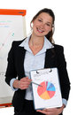Businesswoman showing pie chart cute young during meeting Royalty Free Stock Image