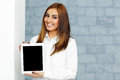Businesswoman showing tablet computer display happy confident Stock Photos