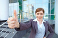 Businesswoman shows thumb. Royalty Free Stock Photos