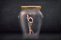 Businesswoman shut inside a glass jar concept on background Stock Photography
