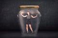 Businesswoman shut inside a glass jar concept Royalty Free Stock Photo