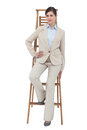 Businesswoman sitting on career ladder white background Royalty Free Stock Photos