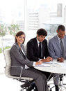 Businesswoman sitting at a conference table Stock Photos
