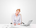 Businesswoman sitting at desc pretty young with plain white copy space Stock Images