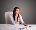 Businesswoman sitting at desk and doing paperwork Royalty Free Stock Image