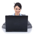 Businesswoman sitting at a desk with a laptop Royalty Free Stock Photos