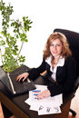 Businesswoman sitting in her office Stock Photo