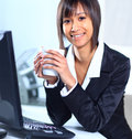 Businesswoman sitting at the table in office lobby Stock Image
