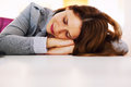 Businesswoman sleeping at office desk tired holding her head on the Royalty Free Stock Image