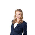 Businesswoman smiling against white background portrait of while standing over Stock Images