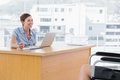 Businesswoman smiling at disabled interviewee her desk in office Royalty Free Stock Photos