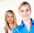 Businesswoman smiling with her colleague Royalty Free Stock Photo
