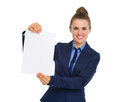 Businesswoman smiling and holding up a blank piece of paper Royalty Free Stock Photo