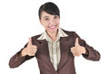 Businesswoman smiling and showing two thumbs up Royalty Free Stock Images