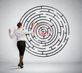 Businesswoman solving maze problem back view image of young trying to find way in labyrinth Royalty Free Stock Image