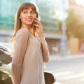 Businesswoman sophisticated in dress talking on the phone Stock Images