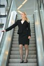 Businesswoman standing on escalator portrait of a Royalty Free Stock Photo
