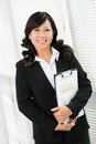 Businesswoman standing sketchboard smiling Stock Images