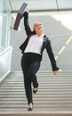 Businesswoman standing on staircase with arm raised in celebration successful Stock Photography