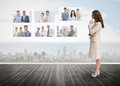 Businesswoman staring at futuristic interface showing partners Royalty Free Stock Photo