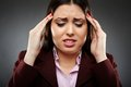 Businesswoman with a strong migraine Stock Photos