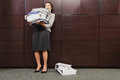 Businesswoman struggling with heavy files Royalty Free Stock Photo