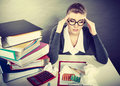 Businesswoman suffering on hard headache. Royalty Free Stock Photo