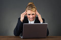 Businesswoman Suffering From Headache At Desk Royalty Free Stock Photo
