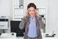 Businesswoman Suffering From Headache In Office Royalty Free Stock Photo