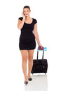 Businesswoman with suitcase portrait of a a making a phone call against a white background Stock Image